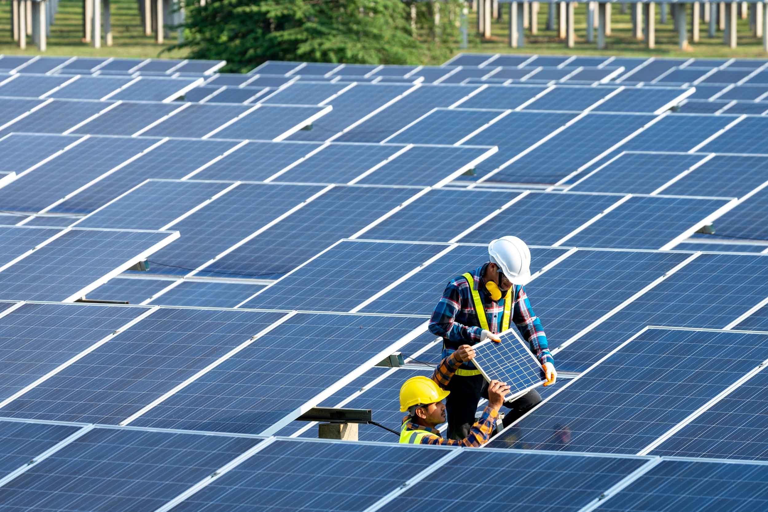 Image of engineers fixing solar panels